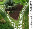 Stone walkway winding in garden - stock photo