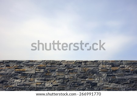 stone wall against  sky - stock photo