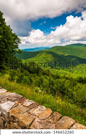 Stone wall and view of the Blue Ridge at an overlook on Skyline Drive in Shenandoah National Park, VA. - stock photo