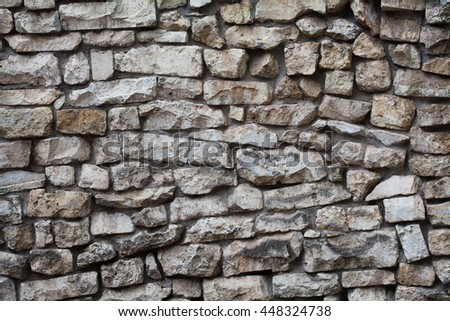 Stone wall background. Textured pattern facade building. macro view, soft focus