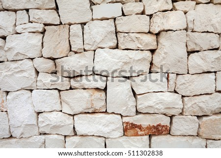 Stone wall background.Textured surface of old building