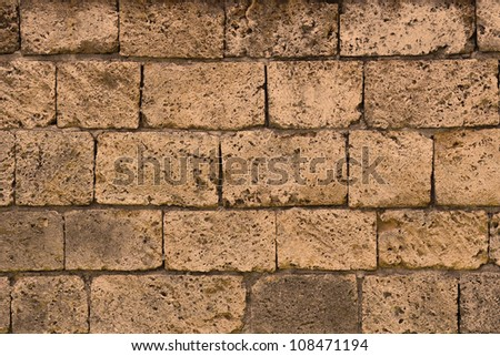 Stone wall background Wall made of cavern rock - stock photo