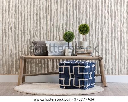 stone wall bank and rug - stock photo