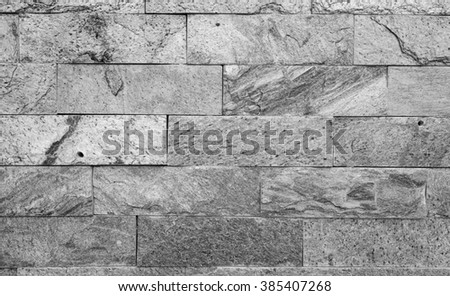 Stone wall black and white texture background - stock photo