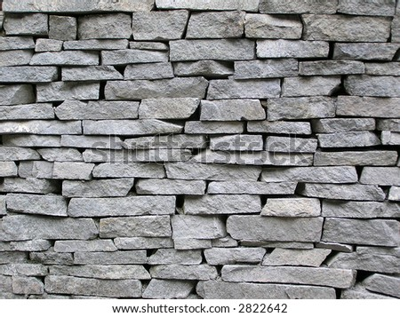 Stone wall, can be used for backgrounds - stock photo