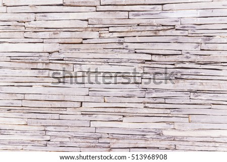 Stone wall cladding texture can be used as background