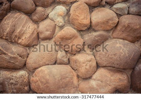 Stone wall constructed by man. Vintage images.