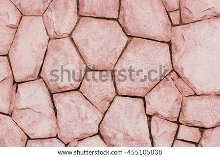 Stone wall constructed of fragments of rock - stock photo
