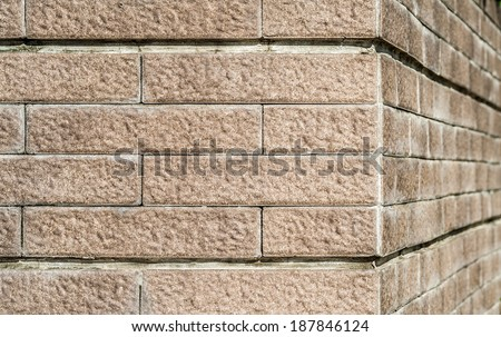 Stone wall corner of building - stock photo