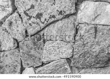 stone wall,cracked stone wall background and texture