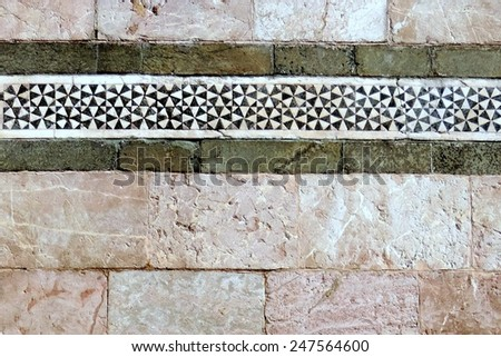 Stone wall decorated with mosaics
