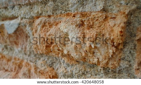 Stone wall decoration texture on modern building facade, artistic architecture pattern wallpaper background
