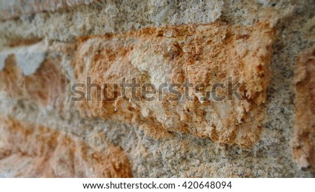 Stone wall decoration texture on modern building facade, artistic architecture pattern wallpaper background , close-up - stock photo