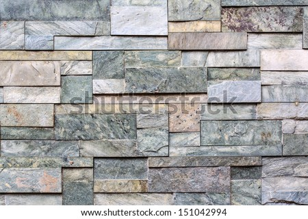 Stone wall, flat stacked background and texture - stock photo