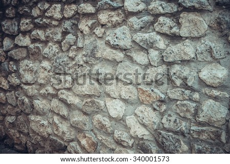 stone wall for background. tinted photo