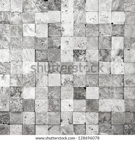 Stone wall from small pieces in gray color - stock photo