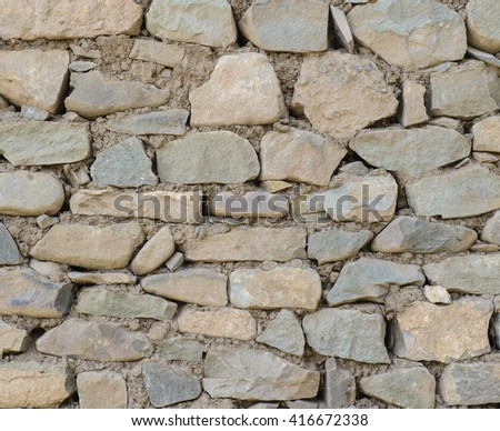 Stone wall full frame texture background - stock photo