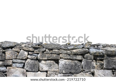 Stone wall isolated on white background - stock photo