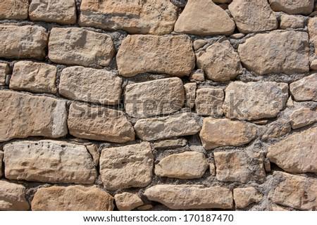stone wall of large stones - stock photo