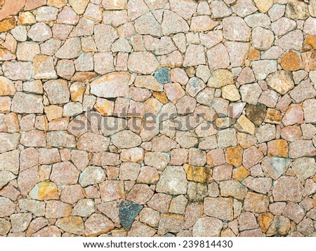 stone wall of the large colored cement bonded granite stones - stock photo