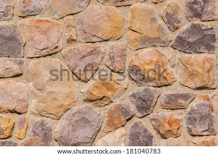 Stone Wall Plaster Background Stone wall section of building with rough outdoor textures and detail for weather conditions.