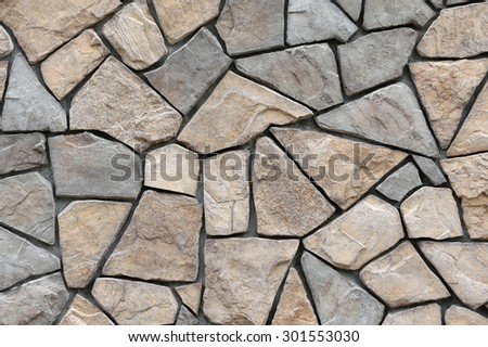 stone wall surface with cement - stock photo