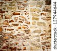 stone wall texture background. closeup of antique stone wall - stock photo