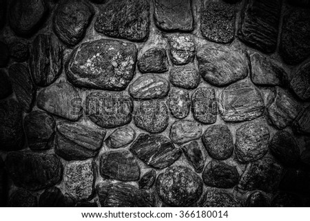 Stone wall texture background closeup with light,black and white - stock photo