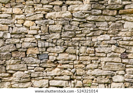 Stone wall texture background natural color. Closeup