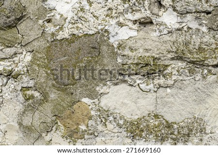 Stone wall texture from a ruined house - stock photo