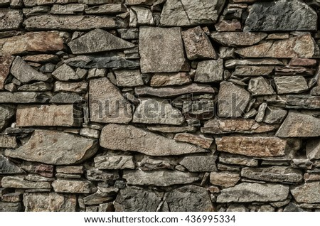 Stone wall texture.Pattern of old stone Wall.Pattern gray decorative uneven cracked real stone wall surface. - stock photo