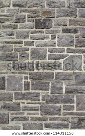 stone wall with cement - stock photo