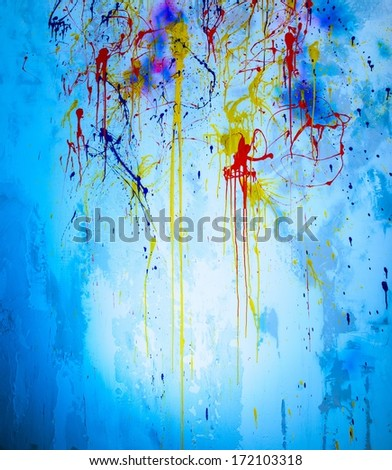 Stone wall with colourful paint splashes on a wall - stock photo
