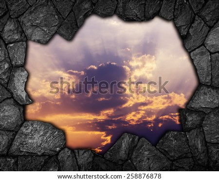 stone wall with hole sky for background - stock photo
