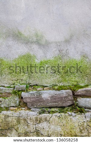 Stone wall with moss - stock photo