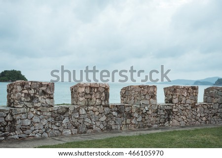 Stone walls and sea.