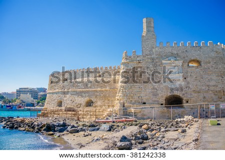 Stone walls of the ancient Venetian fortress of Koules at Heraklion port, Crete, Greece. - stock photo