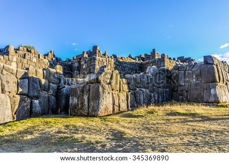 Stone walls of the fortress Saqsaywaman in the capital of Incas, Cusco, Peru - stock photo