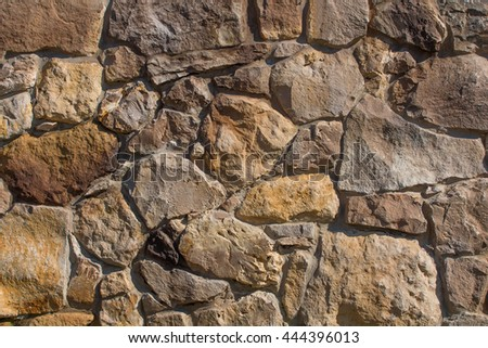 stone walls of yellow stone old wall background