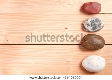 stone zen spa on wooden background  - stock photo