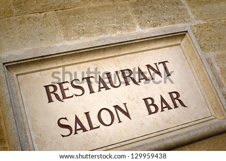 Stoned sign on the facade of a luxury french restaurant - stock photo