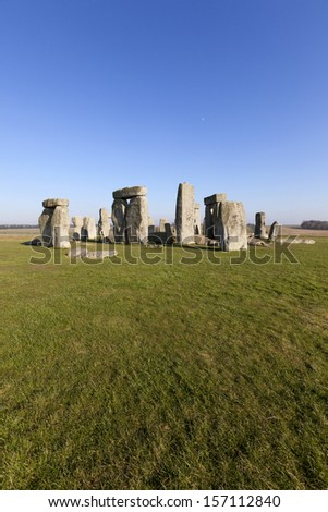 Stonehenge with a blue sky background. Stonehenge is a prehistoric monument in Wiltshire, near Salisbury. UK. - stock photo