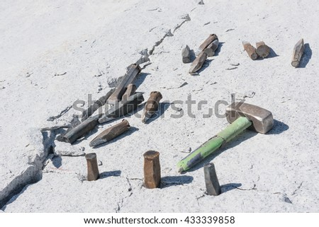 stonemason tools for cutting stone blocks - stock photo