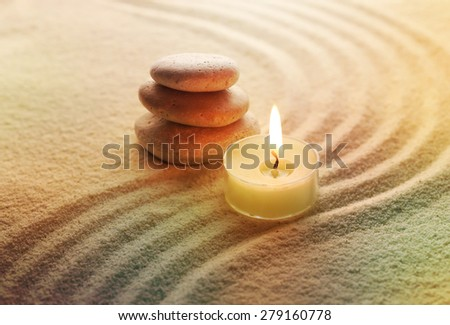 stones and light candle - stock photo