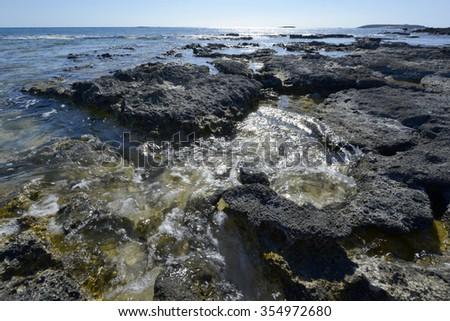 Stones and sea. Southern coast of Crete. Greece - stock photo
