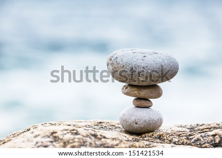 Stones balance, pebbles stack over blue sea. Crimea, Ukraine, Europe. Beauty world. - stock photo