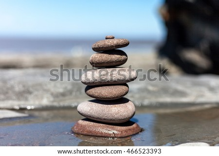 Stones balanced background rock sea