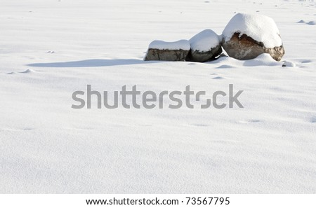 Stones covered in snow on a cold winter day