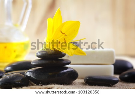 stones for spa and yellow flower - stock photo