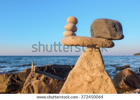 Stones in balance on the seashore - stock photo